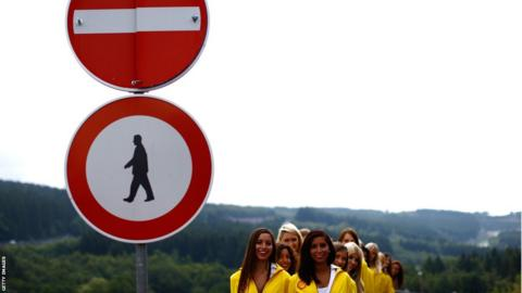 Grid girls are seen lining up before the Belgian Grand Prix at Circuit de Spa-Francorchamps
