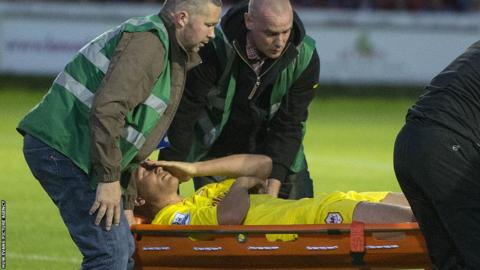 Cardiff City's £7.5m signing Andreas Cornelius is stretchered off during the 2-0 win over Accrington