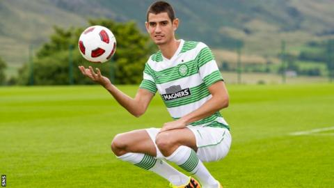 Israel midfielder Nir Biton poses in his new Celtic kit