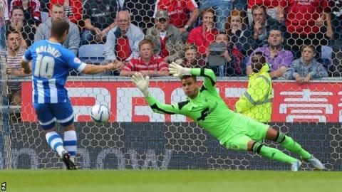 Wigan Athletic's Shaun Maloney scores against Nottingham Forest at the DW Stadium
