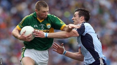 Dublin's Michael Darragh McAuley attempts to hold up Kerry's Tomas O Se