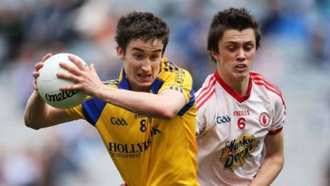Roscommon's Cathal Compton is challenged by Tyrone's Christopher Morris during the All-Ireland semi-final
