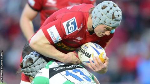 Jonathan Davies in action for the Scarlets