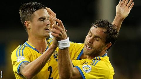 Johan Elmander celebrates his Swedish goal with Mikael Lustig