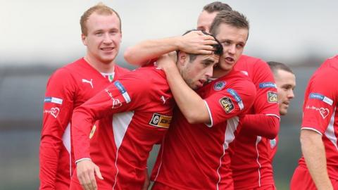 Cliftonville players celebrate Joe Gormley's early goal against Ballymena United