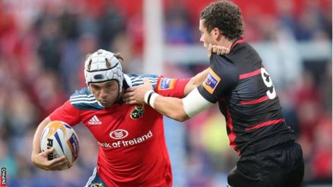 Munster's Duncan Williams attempts to get past Sean Kennedy of Edinburgh