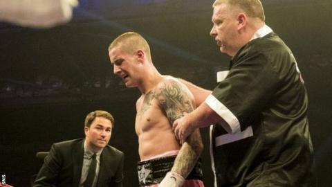 Ricky Burns in pain at the end of Saturday's fight