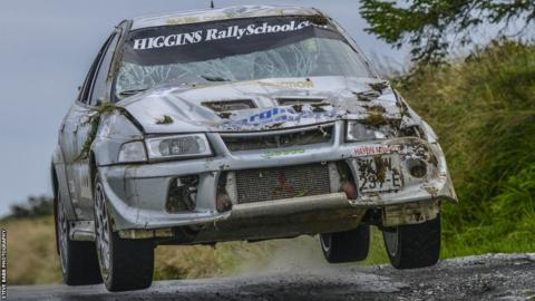 Manx pair, Andrew Leece & Graham Fargher continuing to race in their Mitsubishi Evo VI despite suffering considerable damage in a crash earlier on stage 14