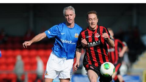 William Murphy and Timmy Adamson challenge for the ball as Crusaders beat Glenavon