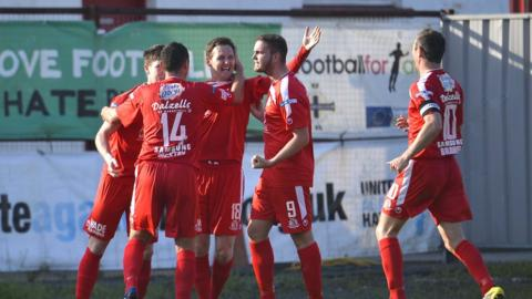 Portadown players celebrate one of their two goals as they go top of the table by beating Glentoran at Shamrock Park