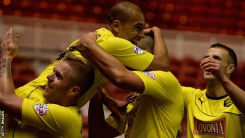 James Vaughan celebrates opening the scoring for Huddersfield