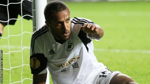 Wayne Routledge celebrates after scoring Swansea's goal