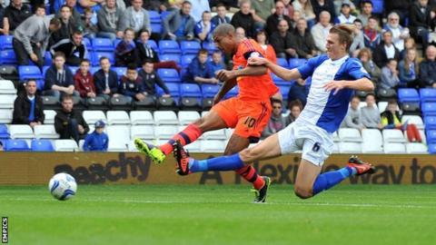 Bolton striker Jermaine Beckford (left) puts his side ahead against Birmingham