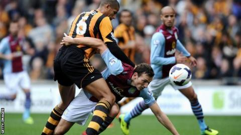 Libor Kozak contests the ball with Curtis Davies