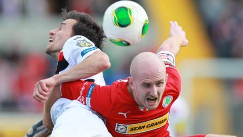 Declan Caddell of Crusaders and Cliftonville's Ryan Catney compete during the north Belfast derby at Solitude which the Crues won 2-0