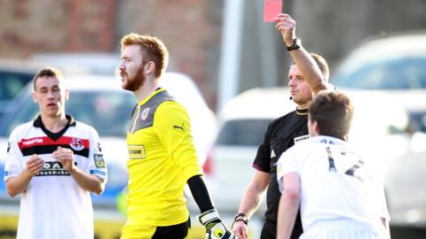 Cliftonville goalkeeper Conor Devlin is sent-off by referee Robert Crangle during the Irish Premiership match against Crusaders