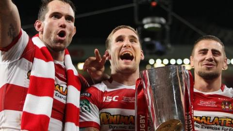 Wigan's Sam Tomkins, Pat Richards and Michael McIlorum celebrate