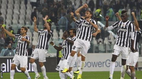 Juventus players celebrate their 3-2 win over AC Milan