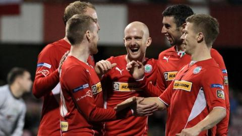 Cliftonville players celebrate the 5-0 victory over Dundela in the League Cup