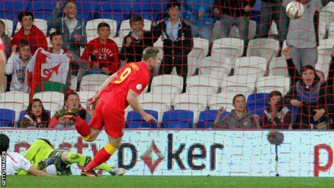 Simon Church scores the second half winner against Macedonia in Cardiff