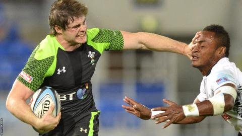 Chris Knight of Wales Sevens breaks away against Fiji in the 2013 Gold Coast Sevens