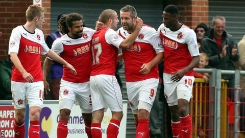 Jon Parkin celebrates his equaliser for Fleetwood against Chesterfield