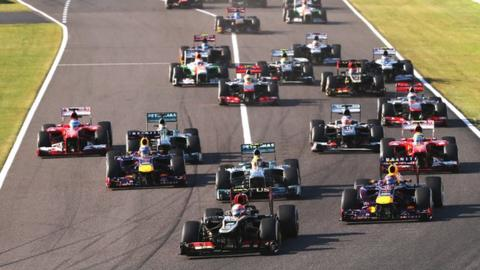 Romain Grosjean leads at the start of the 2013 Japanese Grand Prix