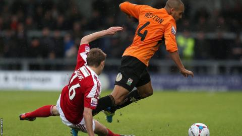 Johnny Hunt of Wrexham is also sent off in the 1-1 draw for this tackle on Curtis Weston, which results in the Barnet player being carried off on a stretcher