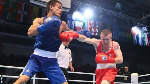 Jasurbek Latipov evades a punch from Paddy Barnes