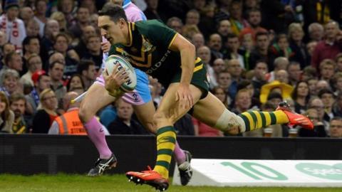 Australia's Billy Slater scores a try