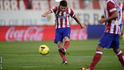 David Villa scores