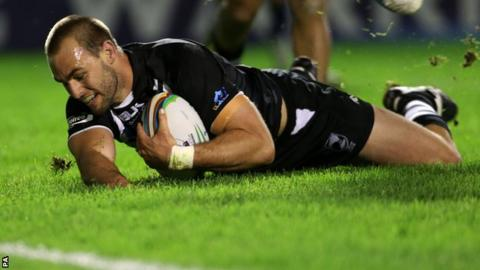 New Zealand captain Simon Mannering (centre) scores a try during his side's win over Samoa
