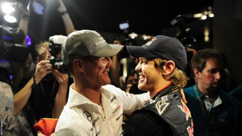 Sebastian Vettel (right) and Michael Schumacher at the 2010 Abu Dhabi Grand Prix