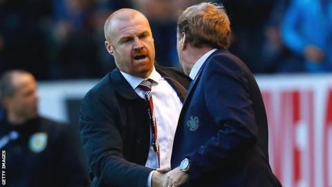 Sean Dyche shakes hands with Harry Redknapp after Burnley's win over QPR
