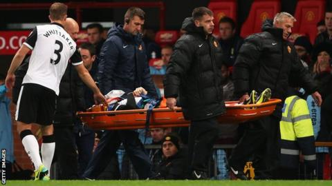 Robert Snodgrass is carried from the pitch on a stretcher
