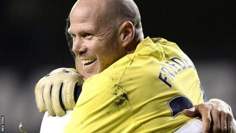 Brad Friedel celebrates Tottenham's Capital One Cup win