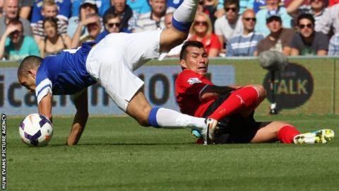 Cardiff's Gary Medel brings down Leon Osman of Everton