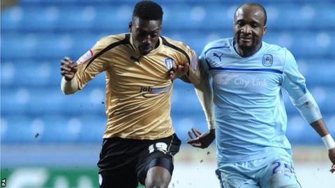 Colchester striker Freddy Ladapo (left)