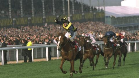 AP McCoy salutes the crowd after winning the 1997 Champion Hurdle at Cheltenham on Make A Stand