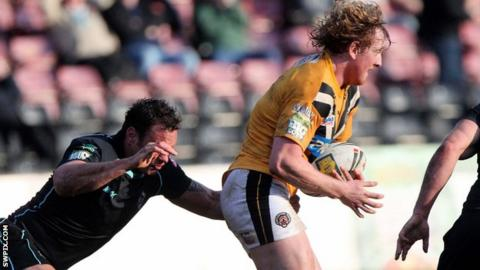 Castleford's Lee Mitchell carries the ball