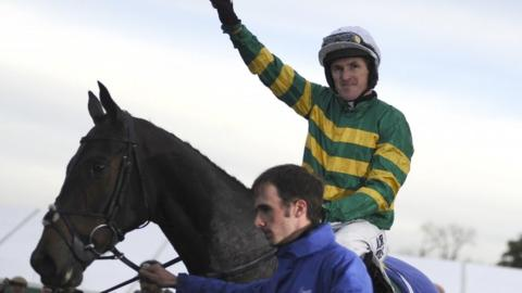 Tony McCoy celebrates his win