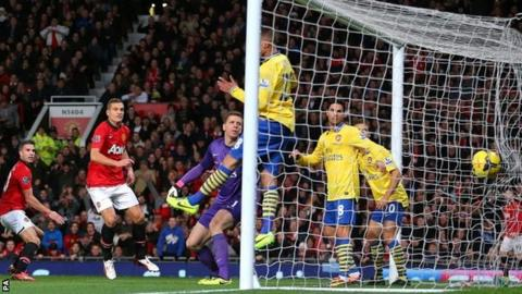 Robin van Persie (far left) scores for Manchester United