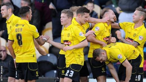Burton Albion celebrate against Hereford United