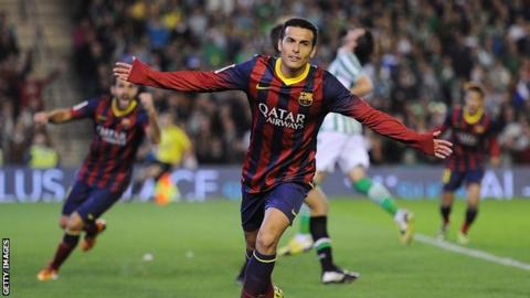 Pedro celebrates scoring for Barcelona against Real Betis