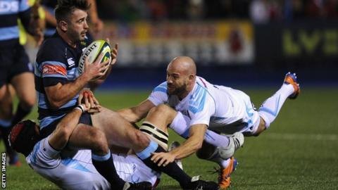 Blues centre Dafydd Hewitt is tackled by Worcester Warriors duo Leonardo Senatore (left) and Paul Hodgson during Friday night's LV = Cup clash at Cardiff Arms Park