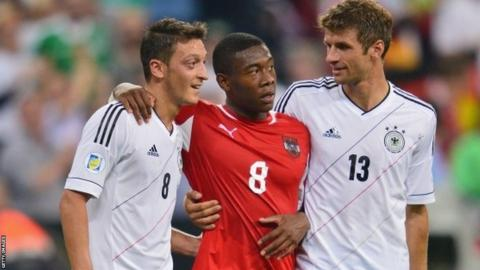 David Alaba of Austria with Mesut Ozil and Thomas Muller during the World Cup qualifier between Germany and Austria