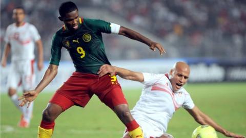 Samuel Eto'o (left) in action against Tunisia