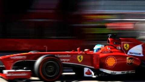Fernando Alonso heads Jenson Button in a delayed first practice session for the US Grand Prix.