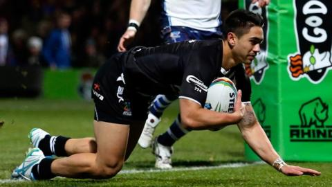 Shaun Johnson of New Zealand dives over to score a try against Scotland at Headingley