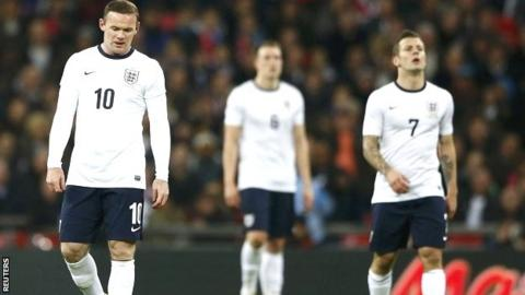Wayne Rooney (left) and Jack Wilshere (right) show their disappointment at Wembley